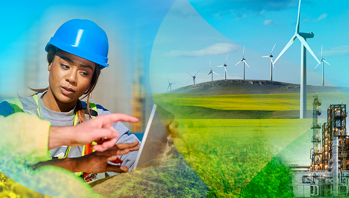 Woman in hardhat, wind turbines, hydrogen production facility