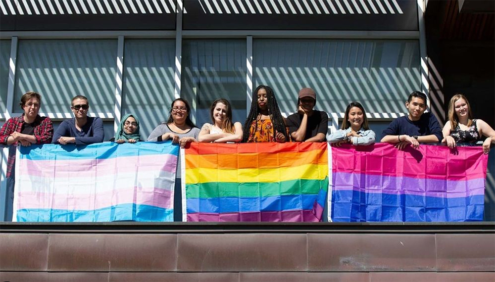 Students with assorted Pride flags