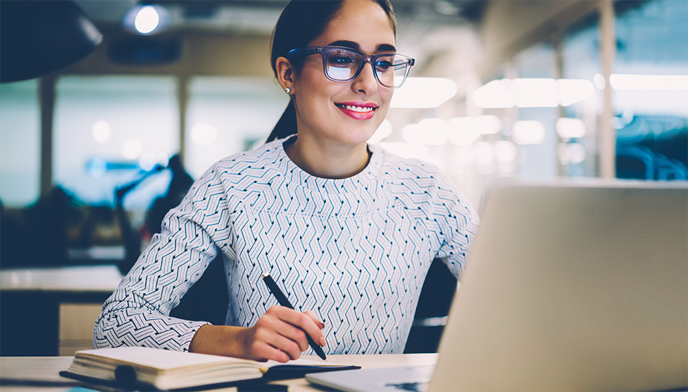 Woman studies at a computer