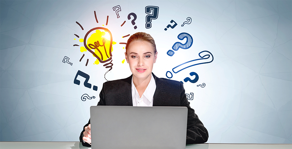 Woman at laptop with question marks surrounding her