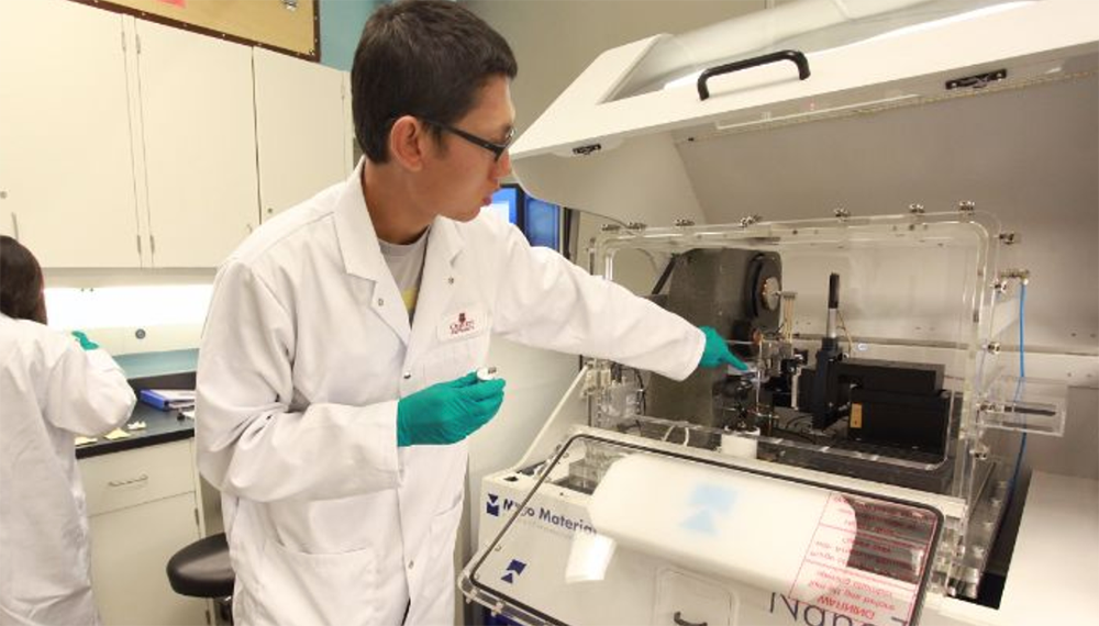 Nuclear researcher works with equipment