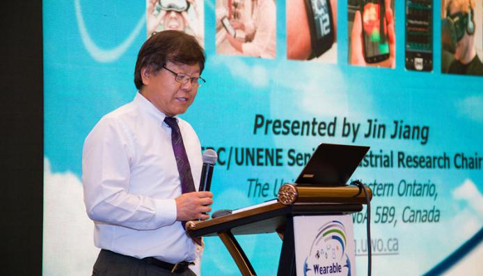 Jing Jiang at podium