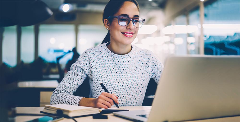 Woman studies with laptop